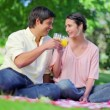 Smiling couple drinking glasses of orange juice — Stock Video