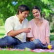 Stock Video: Laughing couple drinking orange juice