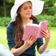 Stock Video: Smiling brunette holding novel