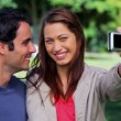 Happy couple taking a picture of themselves — Stock Video