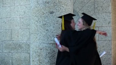 Females graduates embracing each other — Stock Video