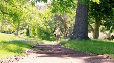 Couple walking with bike — Stock Video