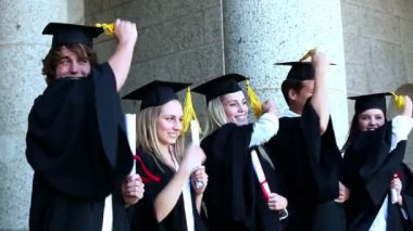 Graduates are passing he tassel from right to left — Stock Video