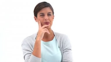Thoughtful woman placing her hand on her chin — Stock Video
