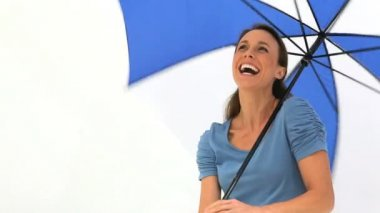 Smiling brunette holding her umbrella — Stock Video