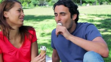 Joyful couple eating ice creams — Stock Video