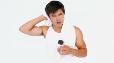 Sweating man drinking water — Stock Video