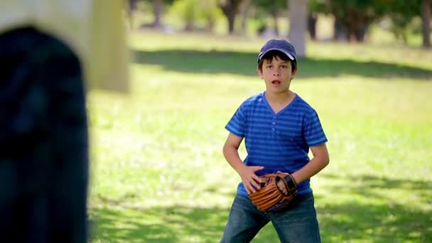 Happy boy catching a baseball while wearing a glove — Vidéo