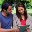 Stock Video: Happy couple holding tablet pc together