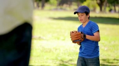 Smiling boy playing baseball while standing upright — Stock Video