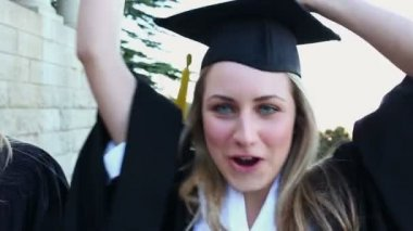 Happy students raising their arms — Stock Video