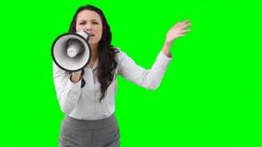 A business woman roaring through a megaphone — Stock Video