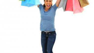 Smiling woman holding shopping bags — Stock Video