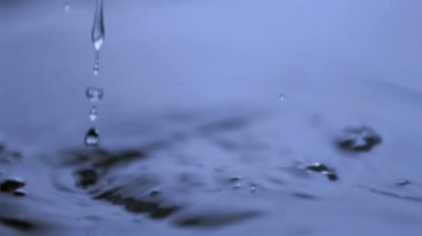 Dripping in super slow motion in water — Stock Video