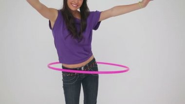 Cheerful woman playing with a hula hoop — Stock Video