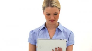 Cheerful blonde woman using a tablet computer — Stock Video