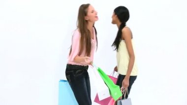 Friends kissing while holding shopping bags — Stock Video
