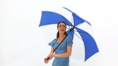 Woman turning her umbrella — Stock Video