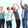 Happy people jumping - Stock Photo