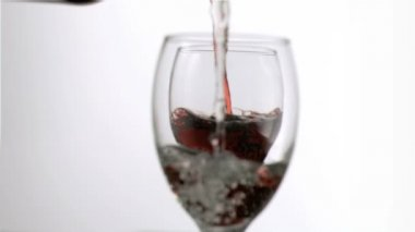 Wine and water filling in super slow motion glasses — Stock Video