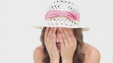 Happy woman wearing a hat while hiding her face — Stock Video