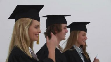 Smiling friends being graduated together — Stock Video