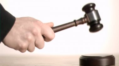 Brown gavel in super slow motion hitting a sound block — Stock Video