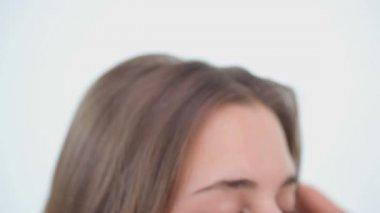 Peaceful woman brushing her brown hair — Stock Video