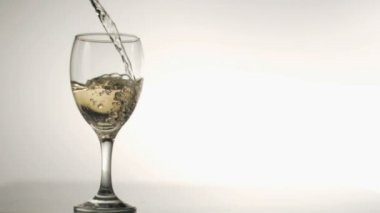 Glass of white wine in super slow motion being filled — Stock Video