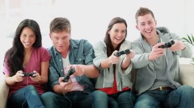 Friends playing video games while laughing — Stock Video