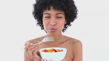 Smiling woman eating a fruit salad — Stock Video