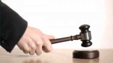 Brown gavel in super slow motion striking a sound block — Stock Video