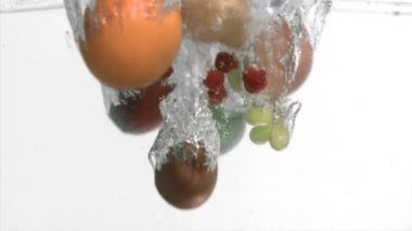 Fruits in super slow motion falling in the water — Stock Video