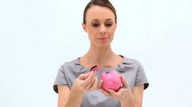 Businesswoman holding an empty piggy-bank — Stock Video