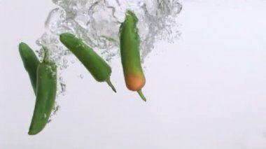 Green peppers in super slow motion being wet — Stock Video