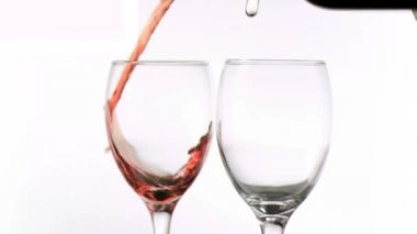 Wines being poured in super slow motion in glasses — Stock Video