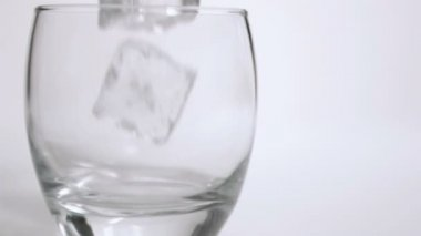 Ice cubes in super slow motion put in a tumbler — Stock Video