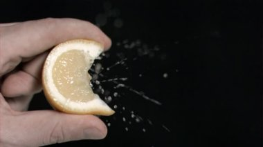 Lemon in super slow motion being squeezed — Stock Video