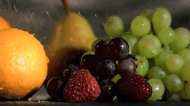 Close-up of fruits watered in super slow motion — Stock Video