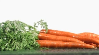 Tasty carrots in super slow motion receiving raindrops — Stock Video