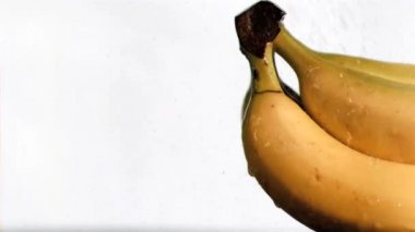 Bananas in super slow motion being soaked — Stock Video