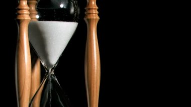 Egg timer in super slow motion against a black background