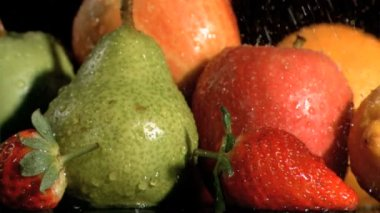 Fruits watered in super slow motion — Stock Video