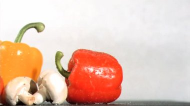 Peppers and mushroom watered in super slow motion — Stock Video
