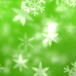 Snowflakes against green background — Vídeo Stock