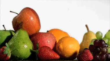 Fruits being soaked in super slow motion — Stock Video