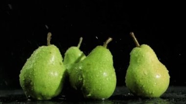 Tasty pears in super slow motion being soaked — Stock Video