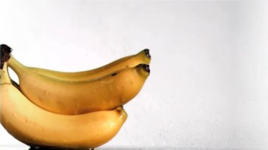 Delightful bananas in super slow motion being wet — Stock Video