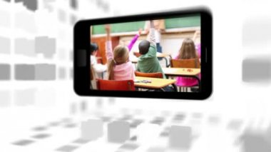 Videos of a primary classroom on a smartphone screen — Stock Video