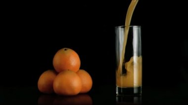 Orange fresh juice poured in super slow motion — Stock Video